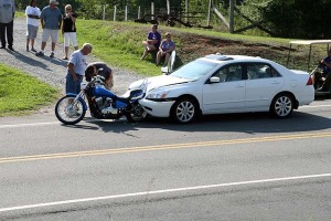 car crash with car and motorcycle
